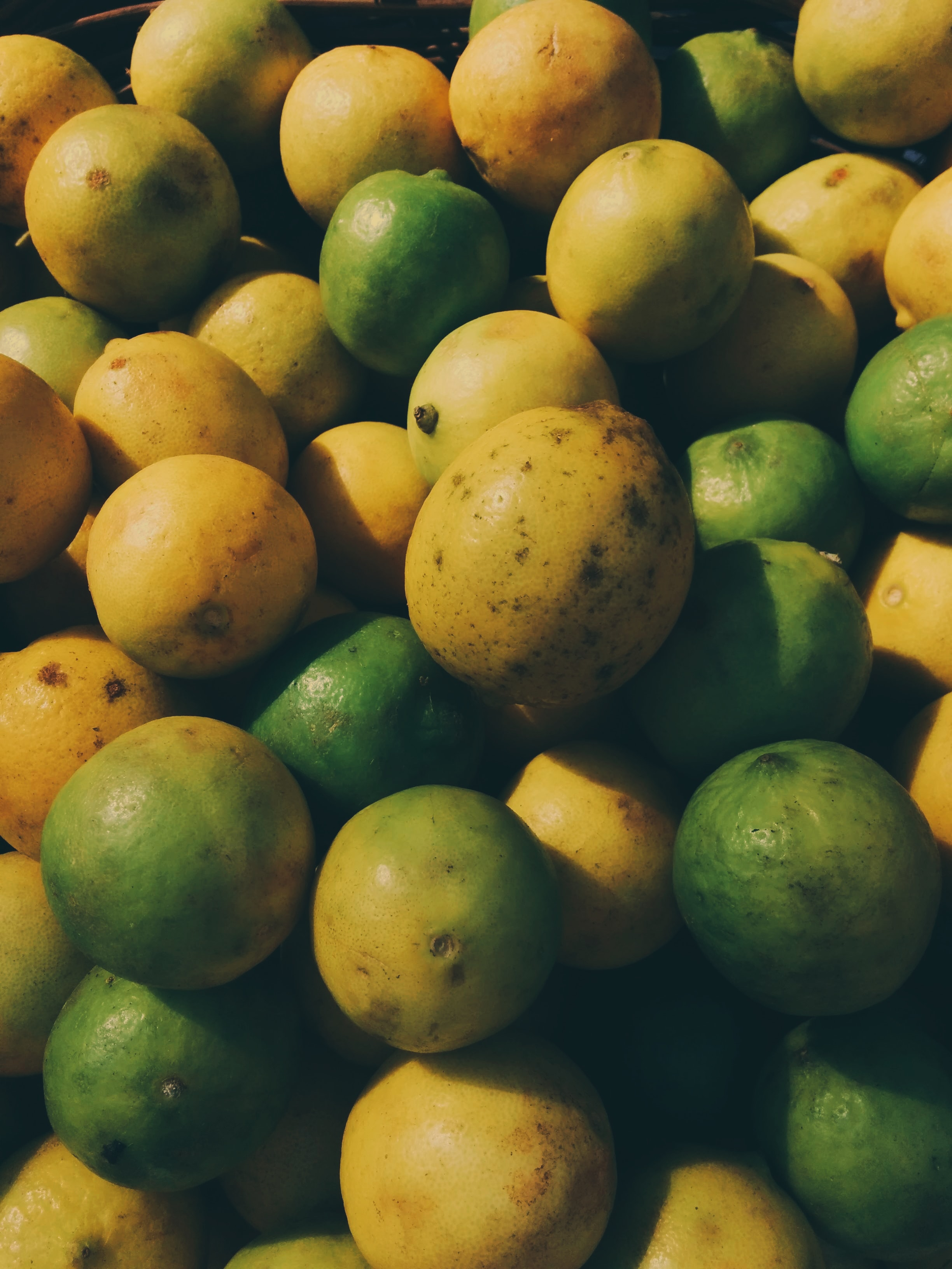 assorted color fruits in green plastic container
