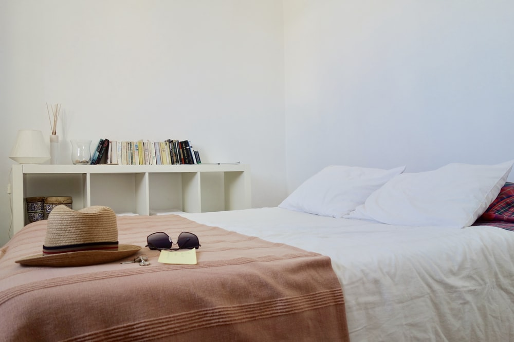 white and brown bedspread