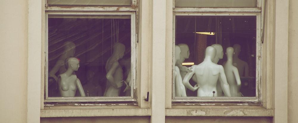 white torso mannequin near window