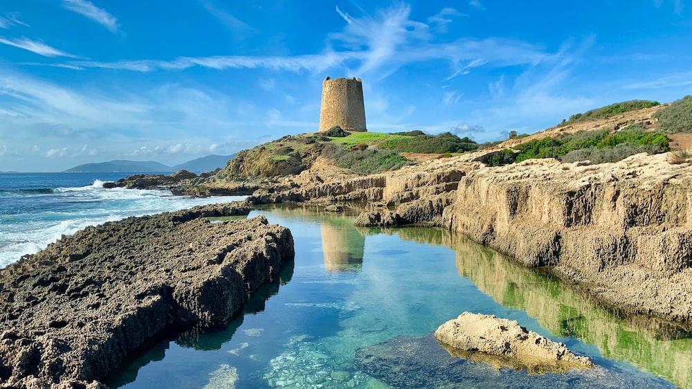watch tower near sea shore