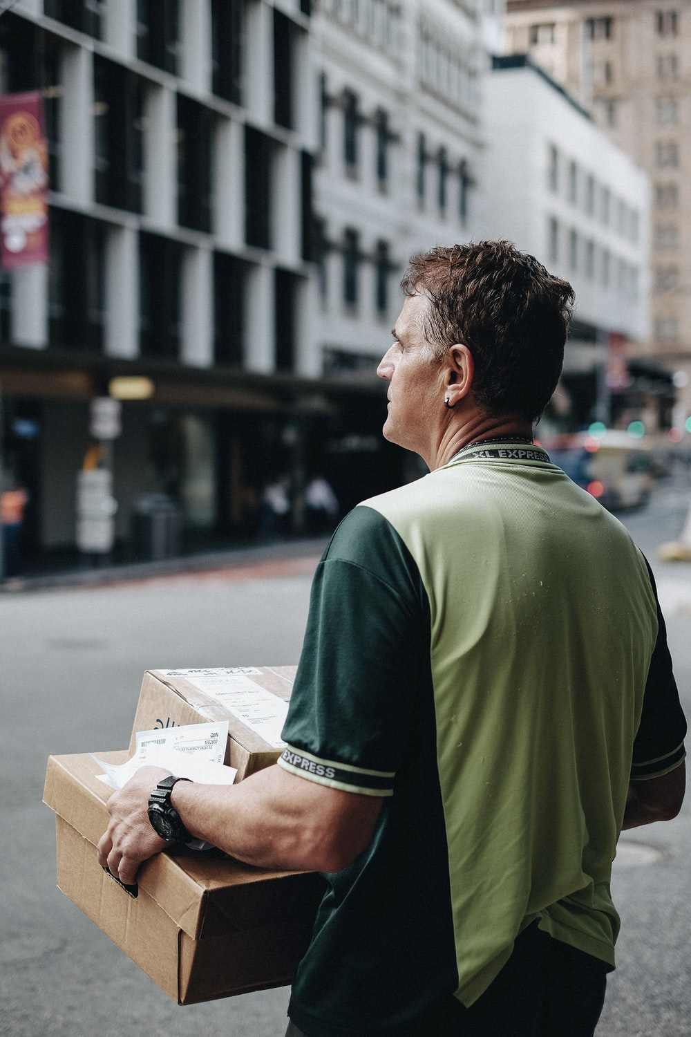 Man holding parcels featured image
