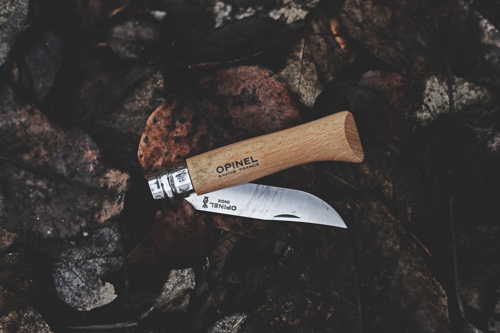 brown and gray Opinel pocket knife