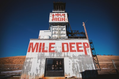 white mile deep labeled steel building montana teams background