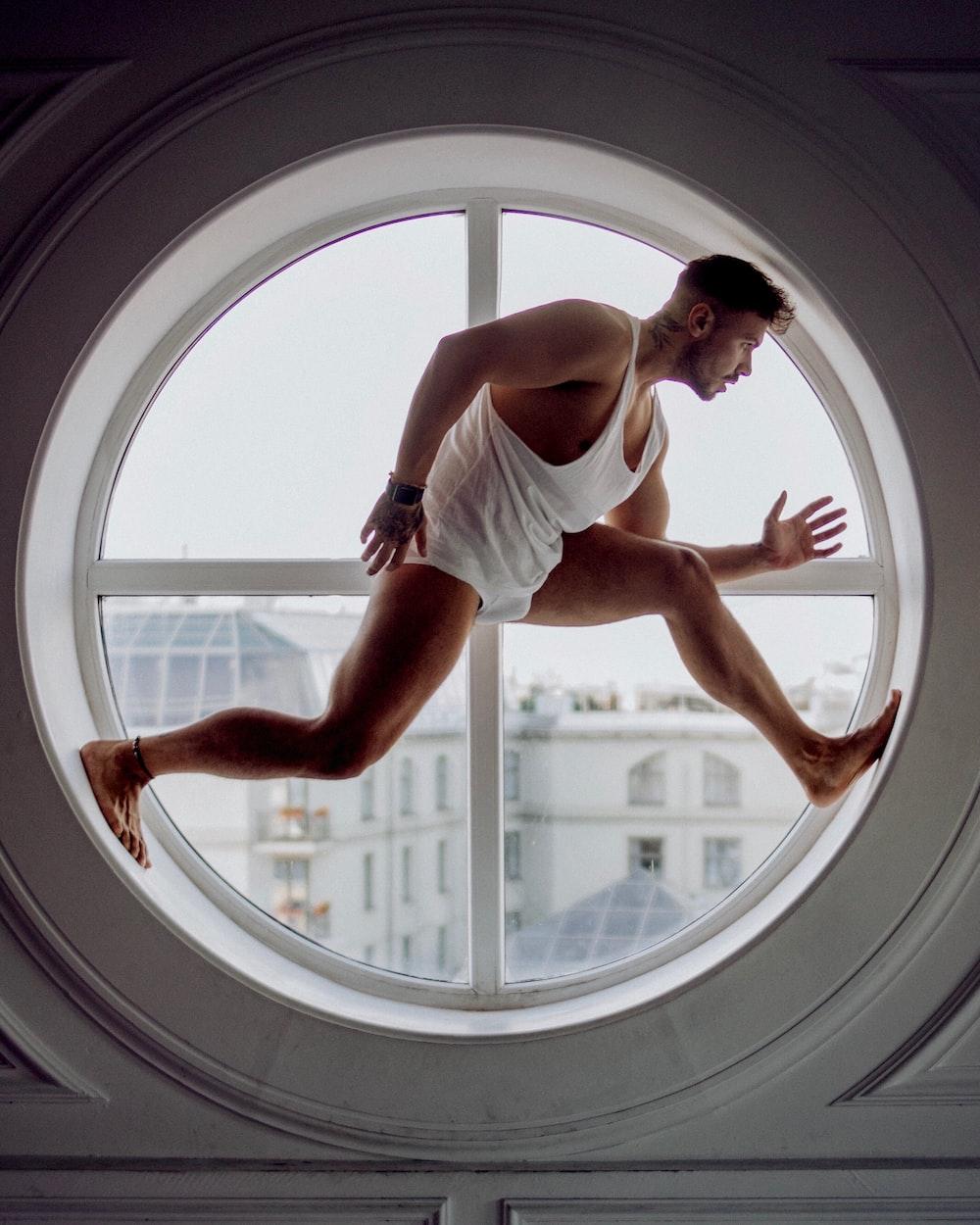man on window frame
