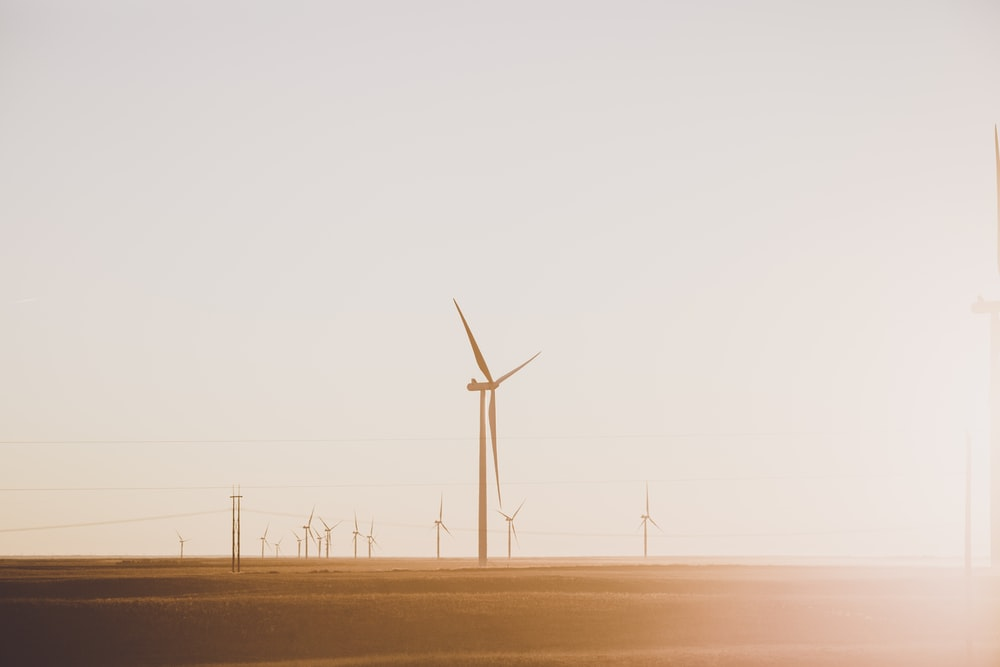 wind turbines under gray sky