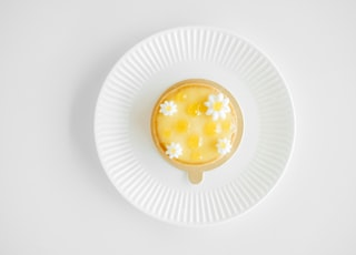 flat-lay photography of custard cake on white plate