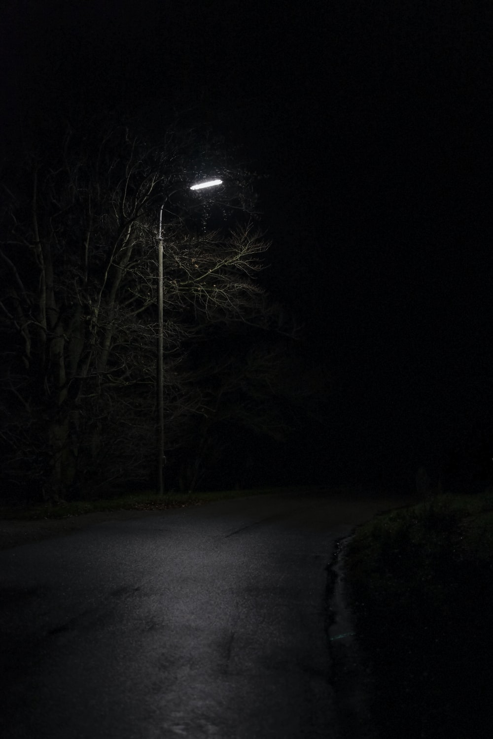 view of empty road under light post
