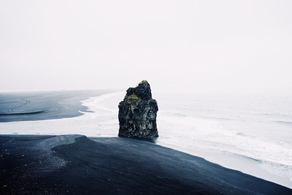 gray rock beside beach