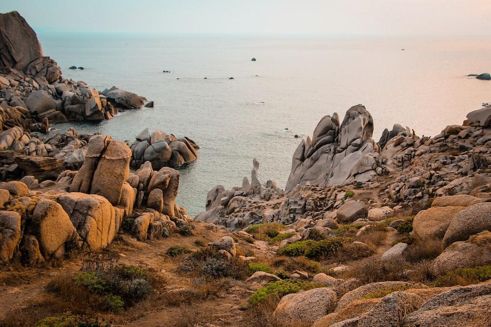 rocky island beside beach