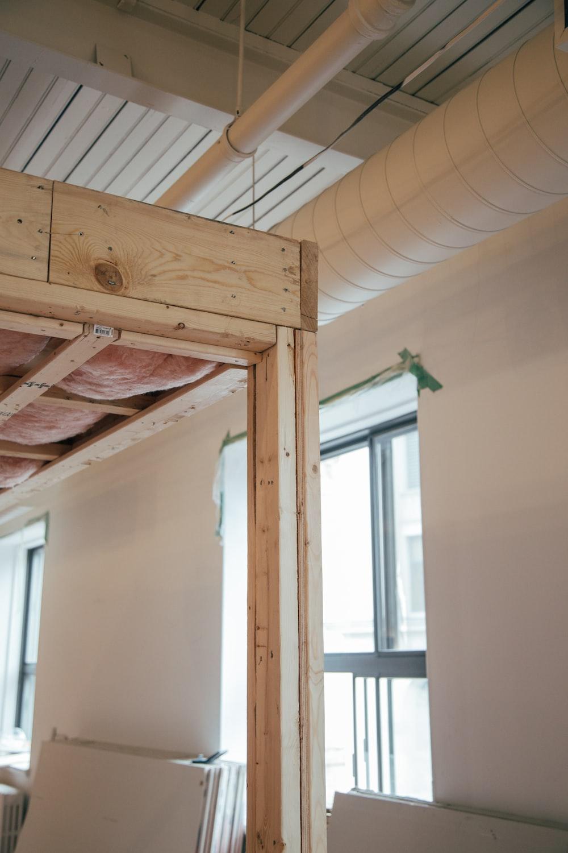 brown wood platform inside room during daytime