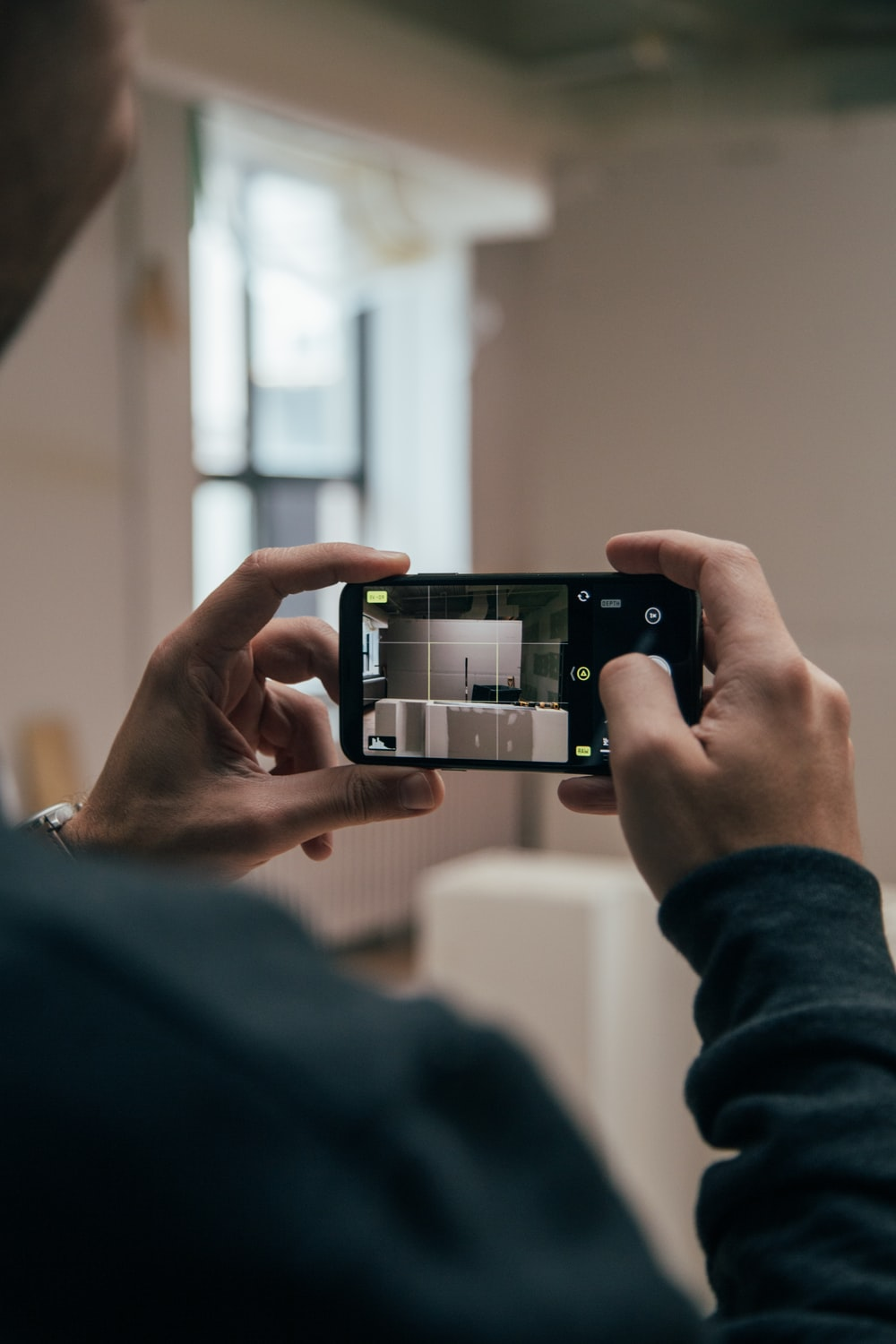 person using smartphone and capturing images