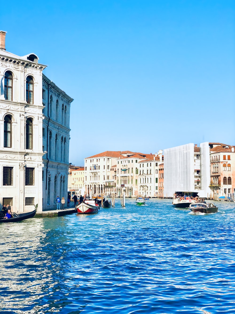 ferries and boats on Grand Canal during daytime