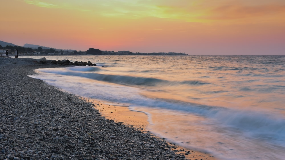 timelapse photography seashore during golden hour