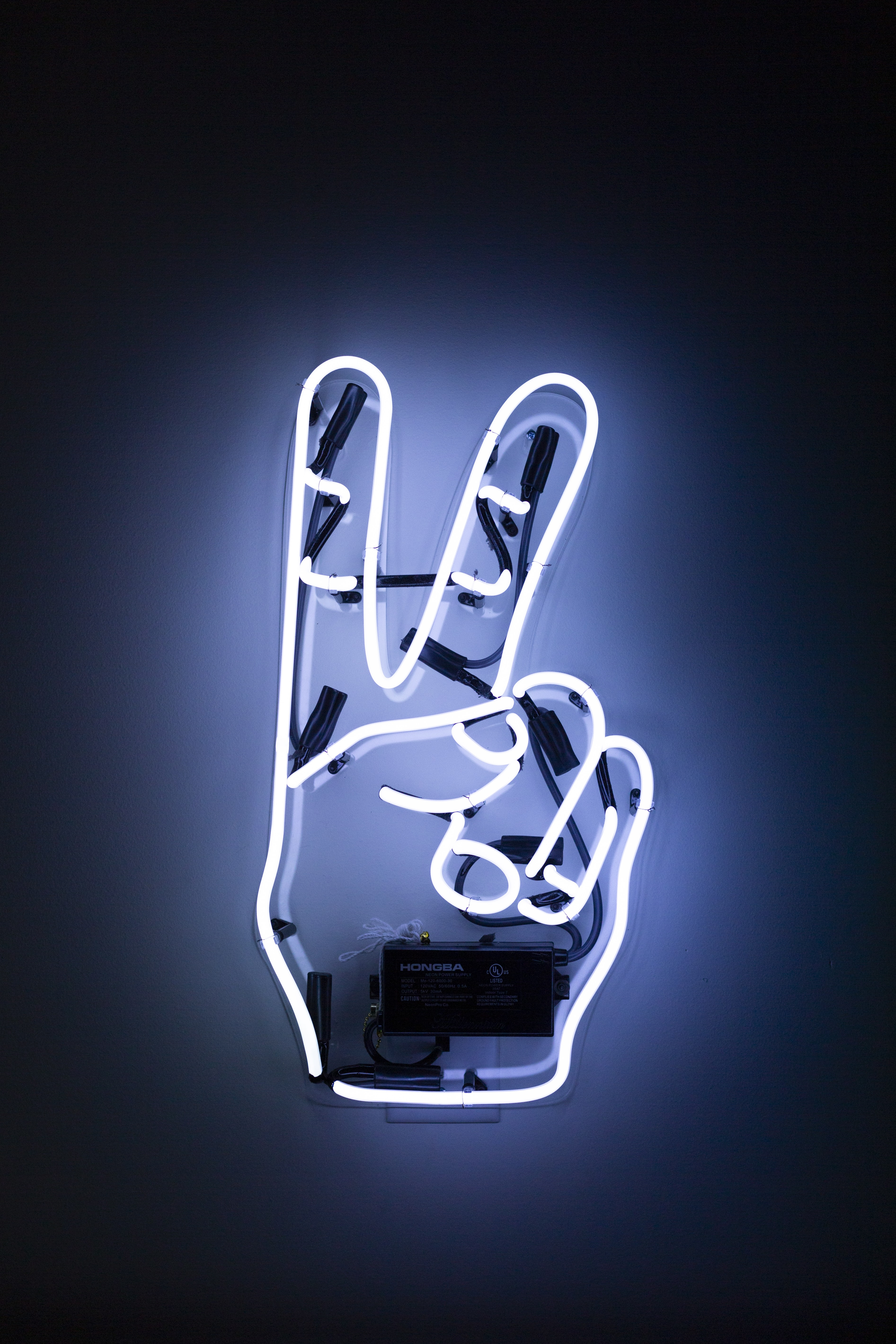 peace hand sign neon light