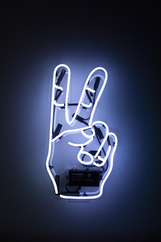 peace hand sign neon light
