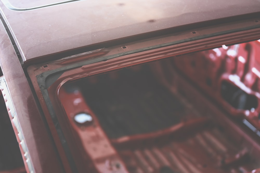 selective focus photography of brown vehicle