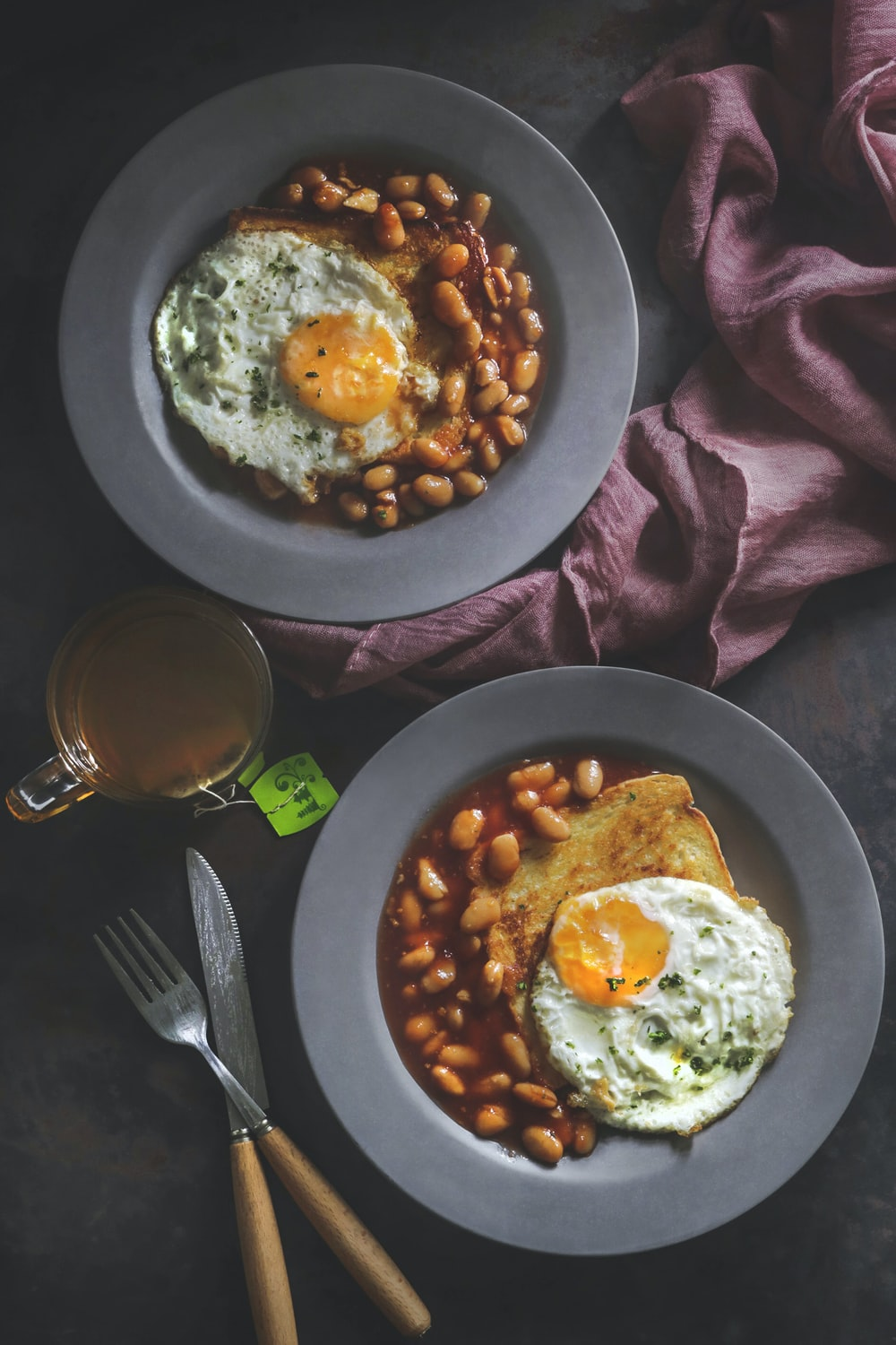 beans and fried egg on plate