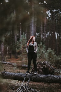 Red headed woman in the woods