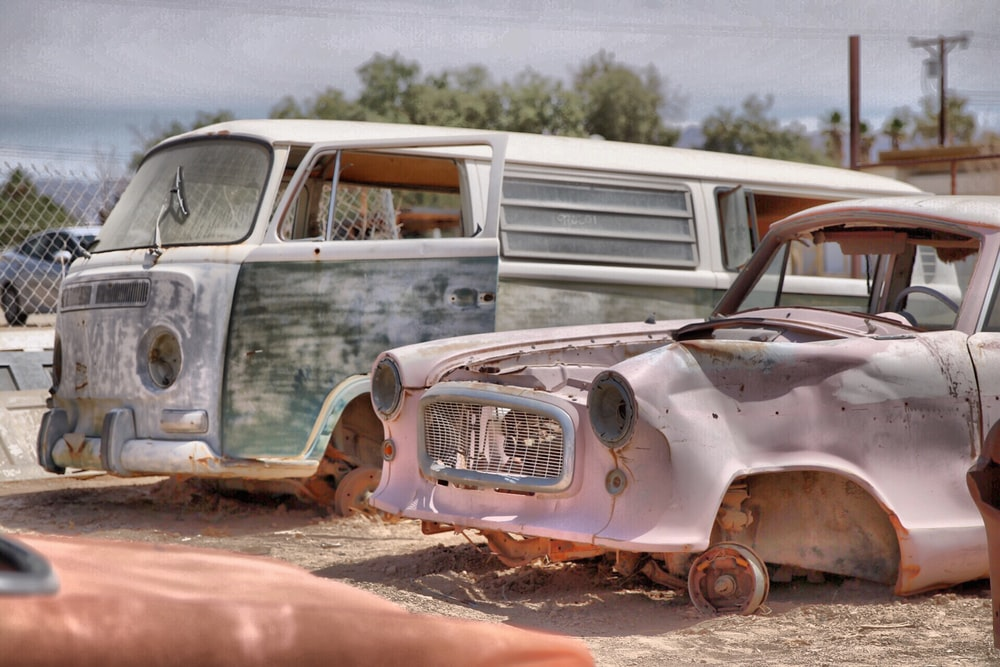 two wrecked van and car