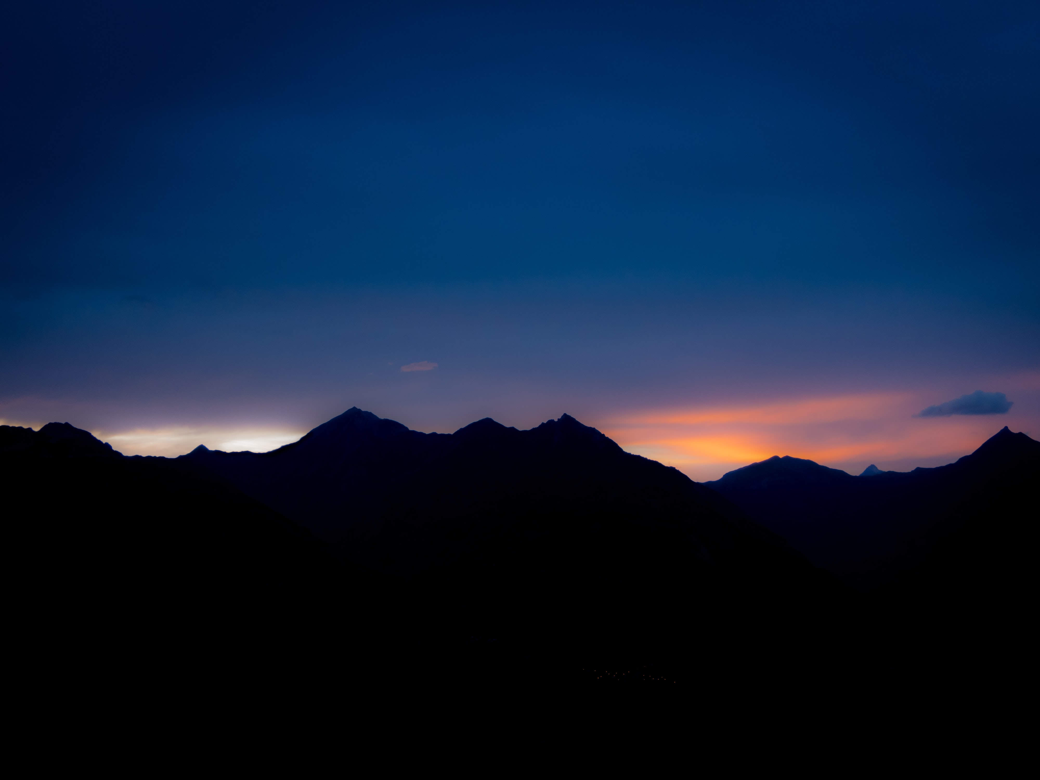 silhouette of rock mountains during golden hour