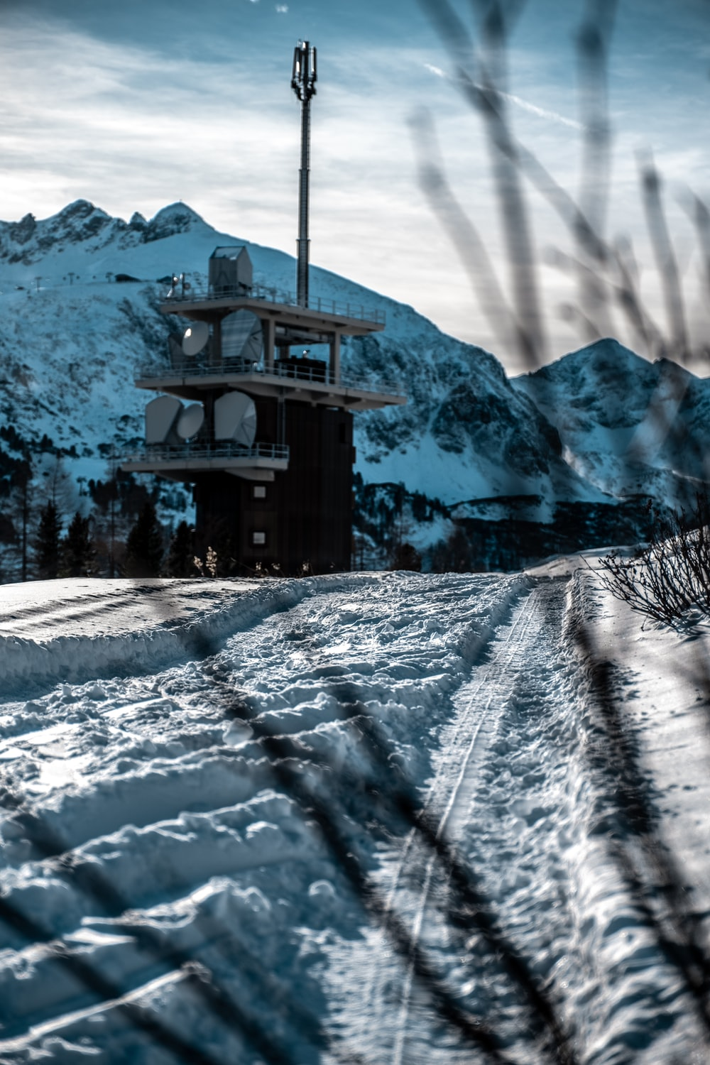 white and black house on snowfield during daytime