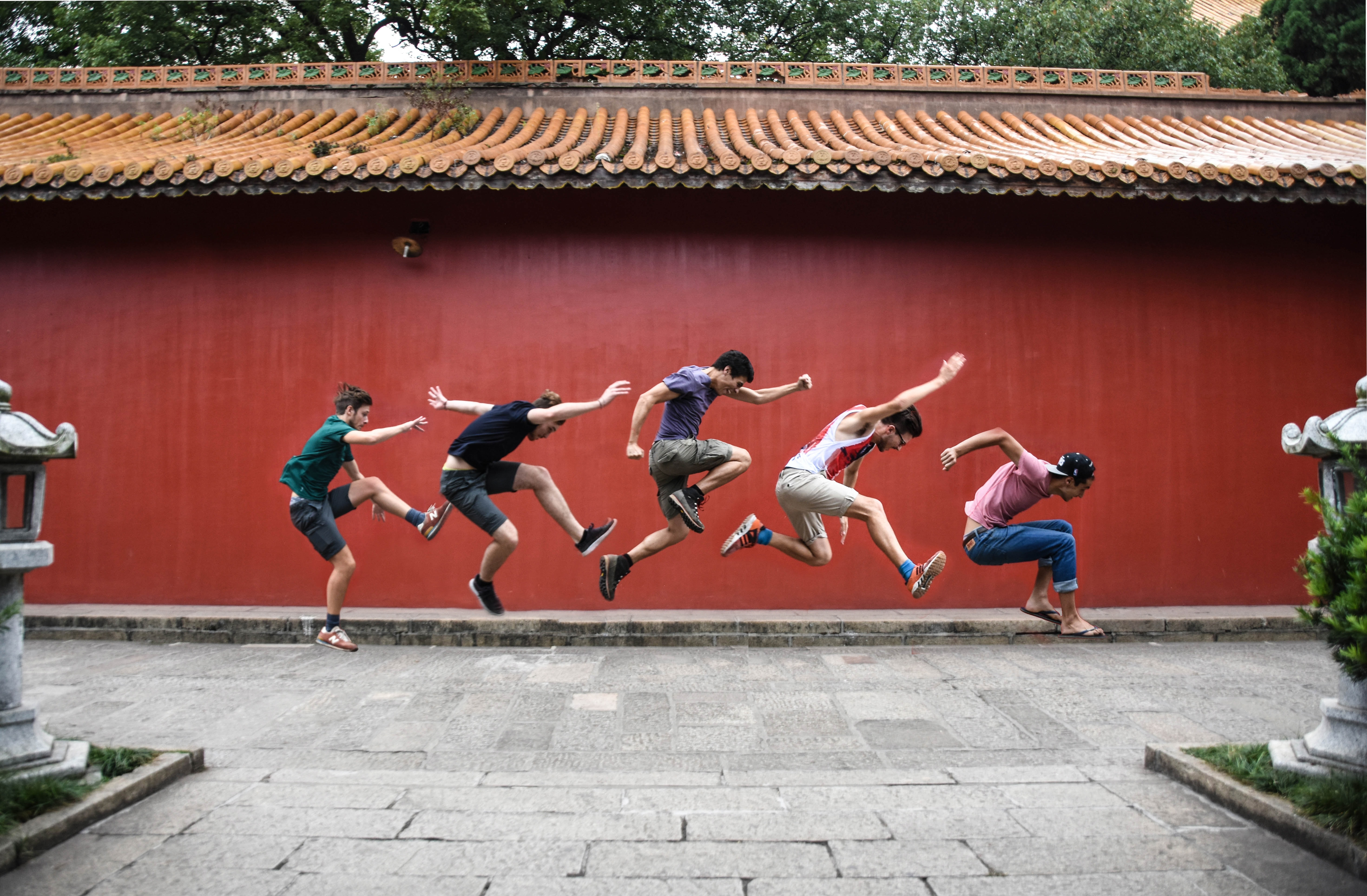 five person jumping