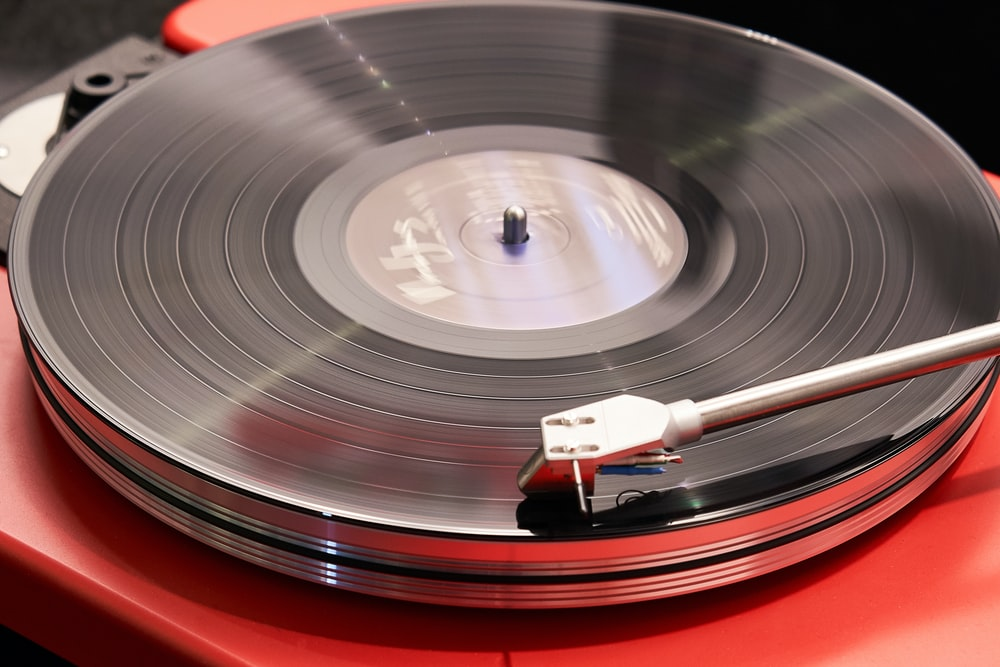 red and grey vinyl player