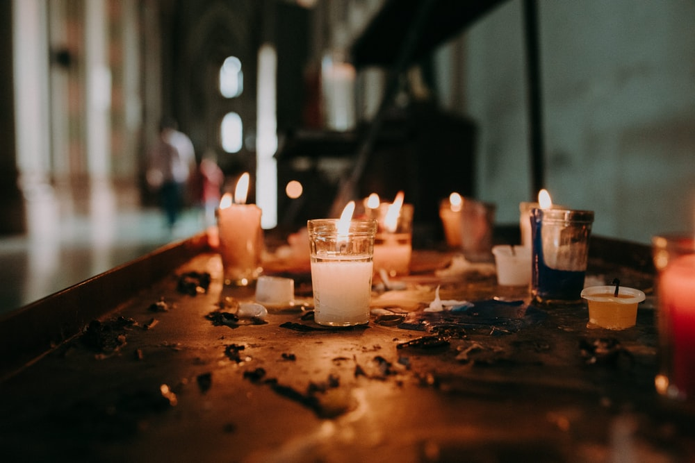white pillar candles lighted in room