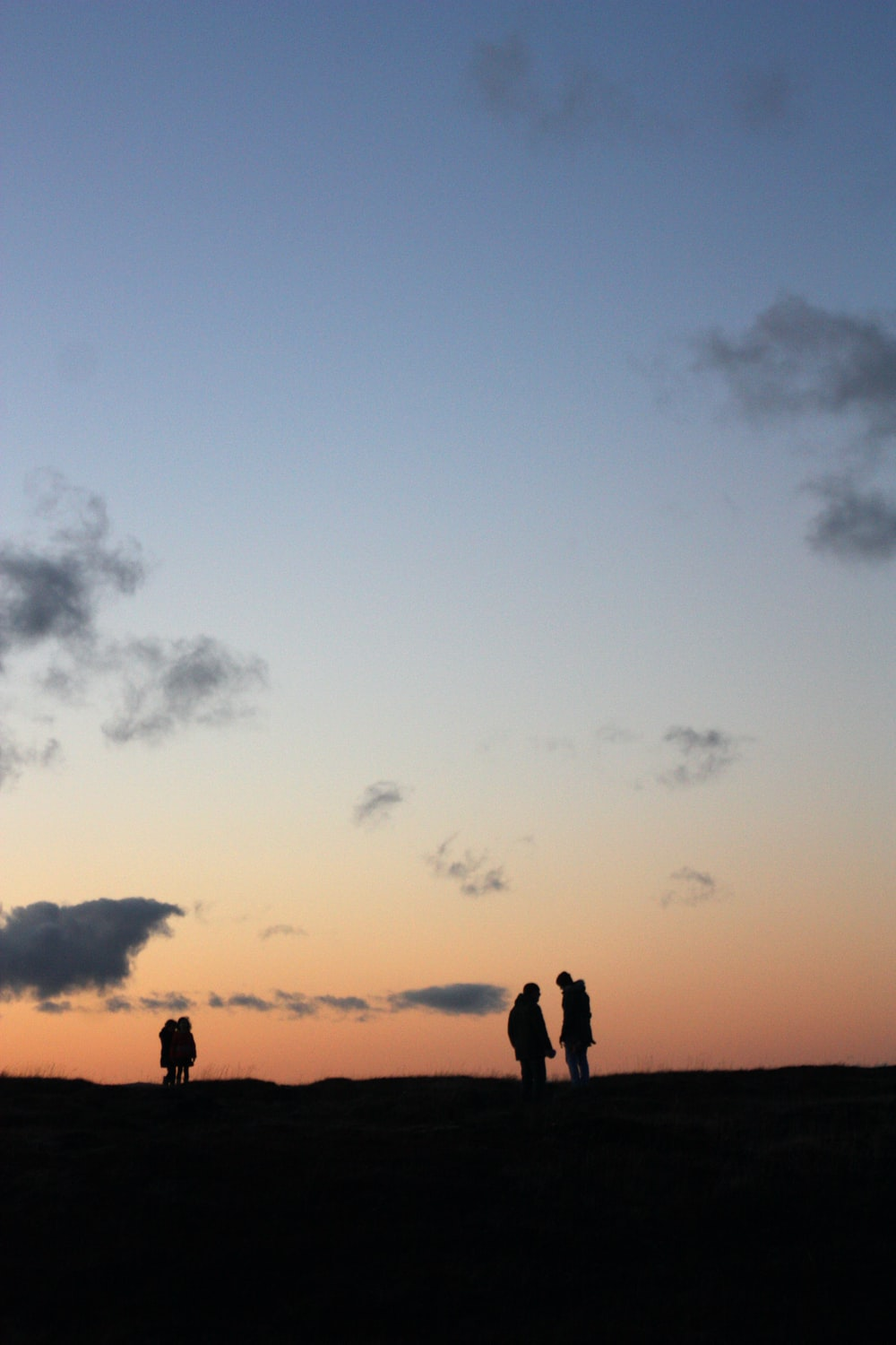 silhouette photography of four people standing