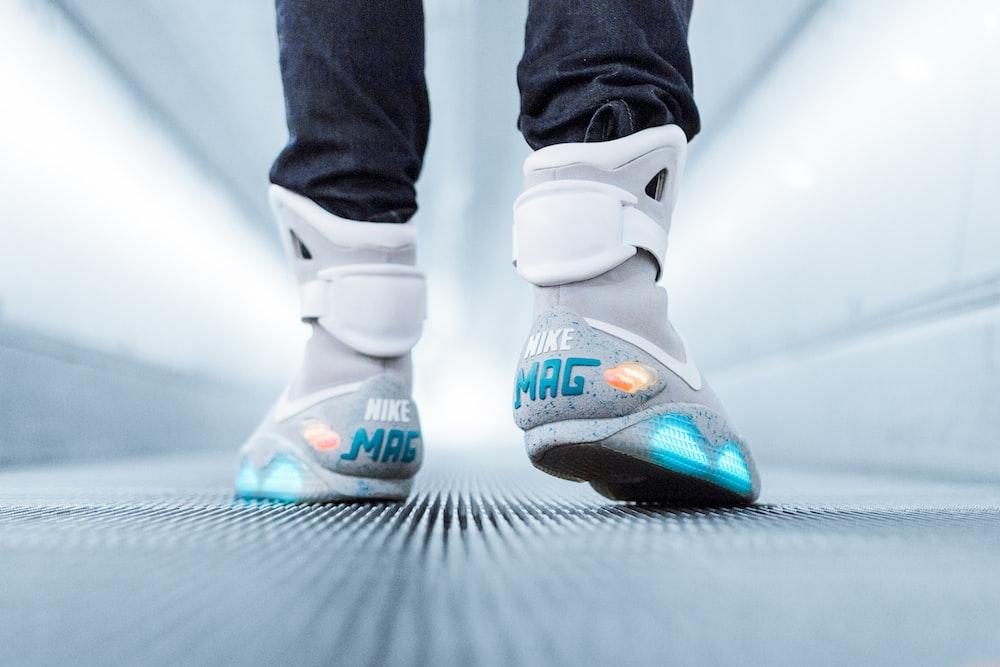 person wearing grey Nike Mag sneakers