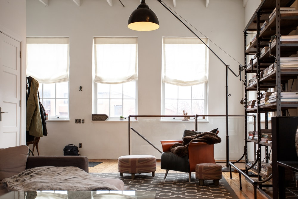 black floor lamp beside sofa chair
