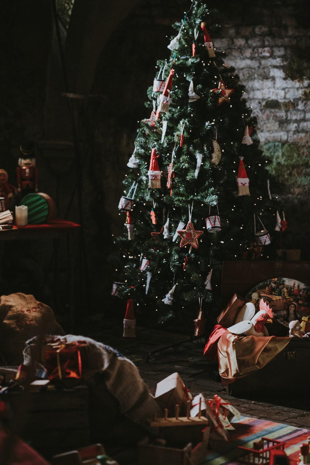 green Christmas tree near wall