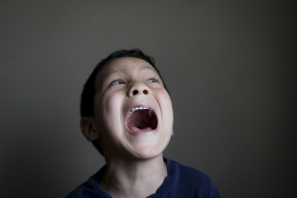 boy opening mouth