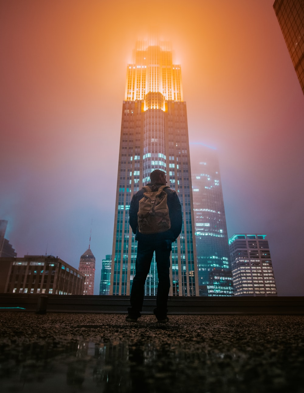 man standing while facing building