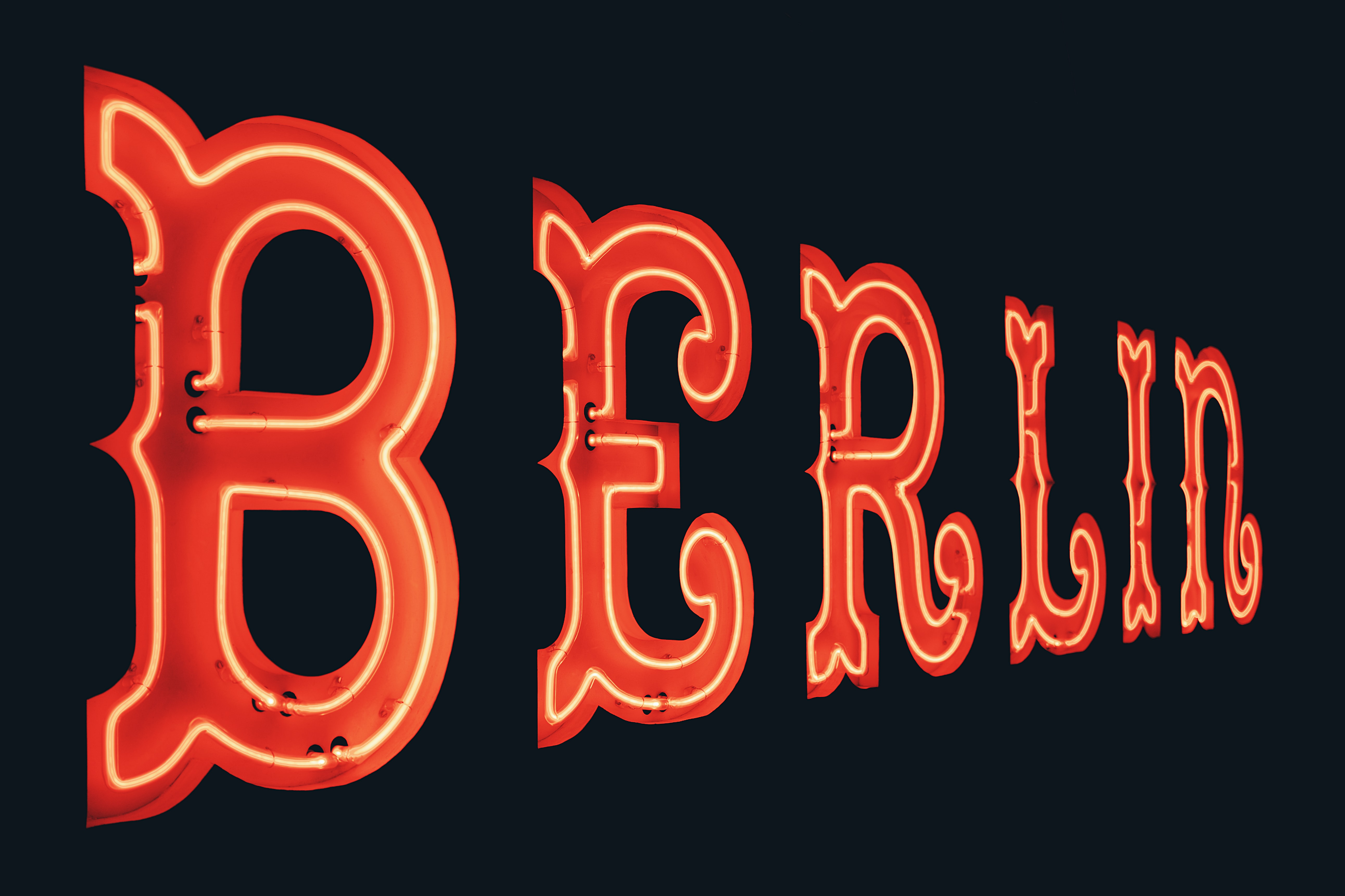 turned on red Berlin neon signage