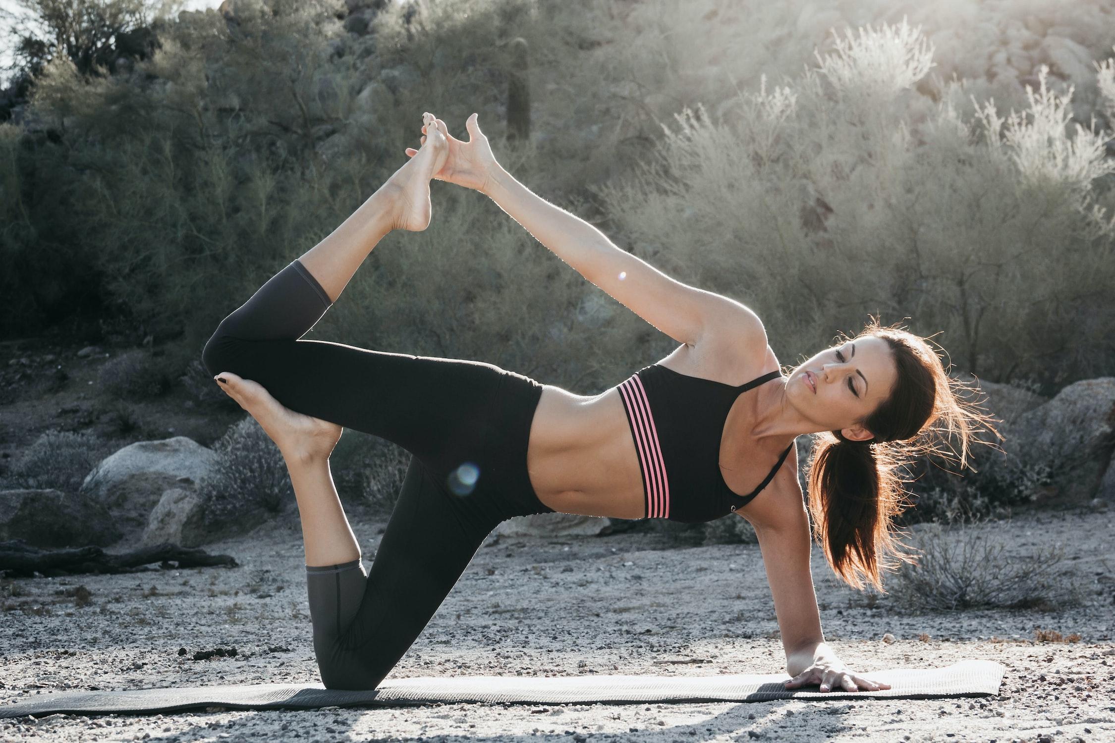 Practicing Yoga - woman in desert