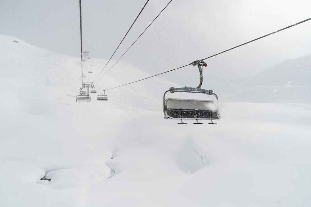black cable car during winter season
