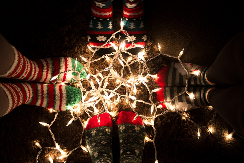 orange string lights surrounded by boots