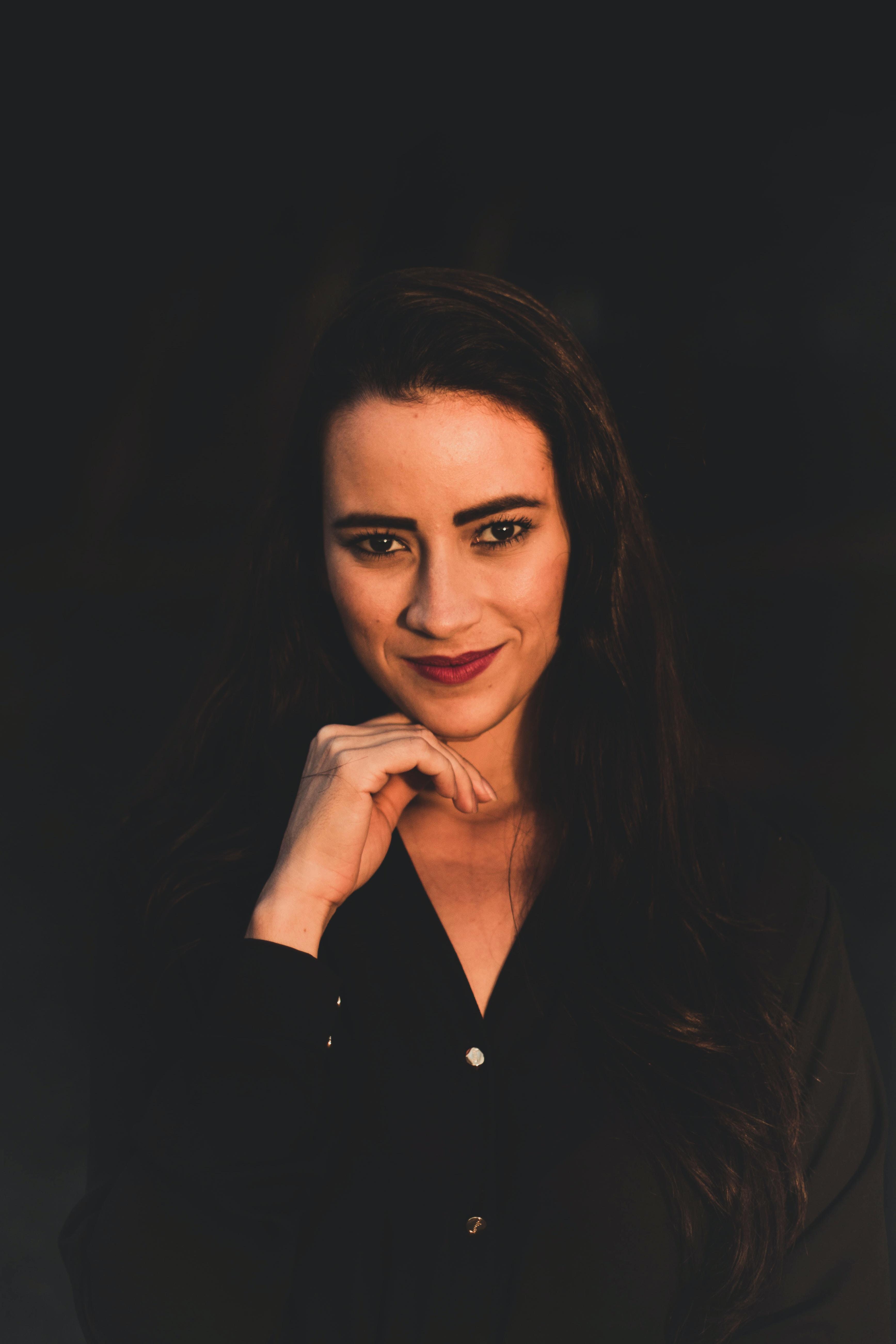 woman wearing black dress shirt making face