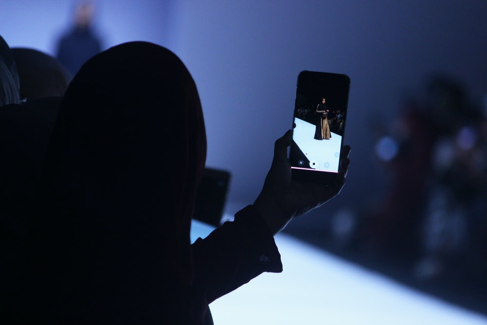 person using phone doing video of woman