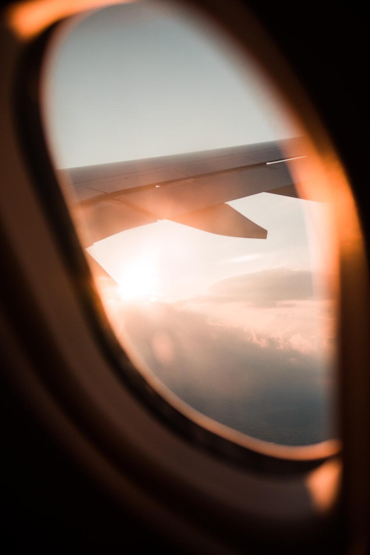 passenger plane window during daytime