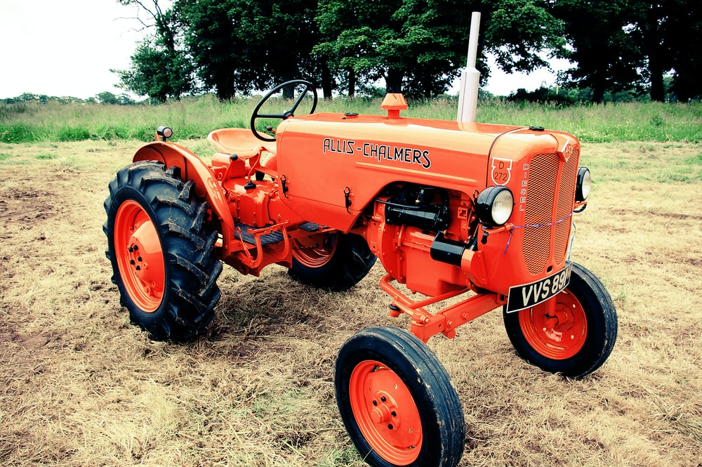 orange tractor on field