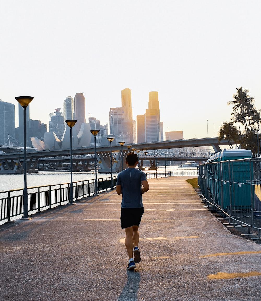 man jogging on street during daytime