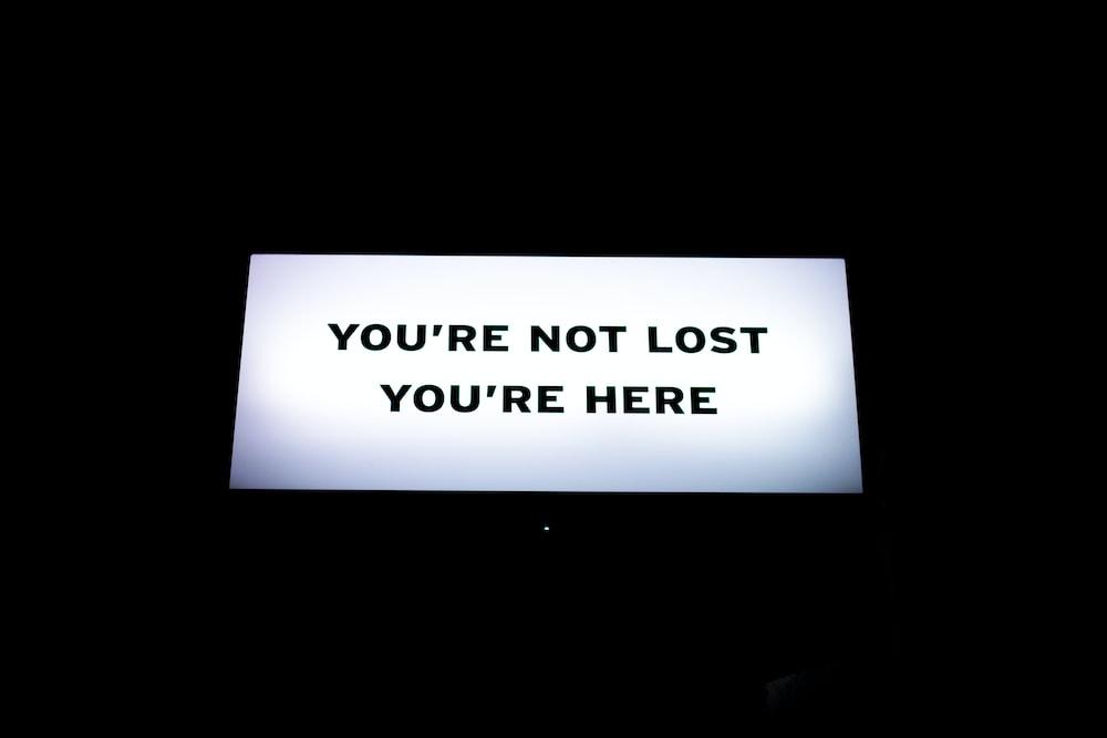 turned-on flat screen TV