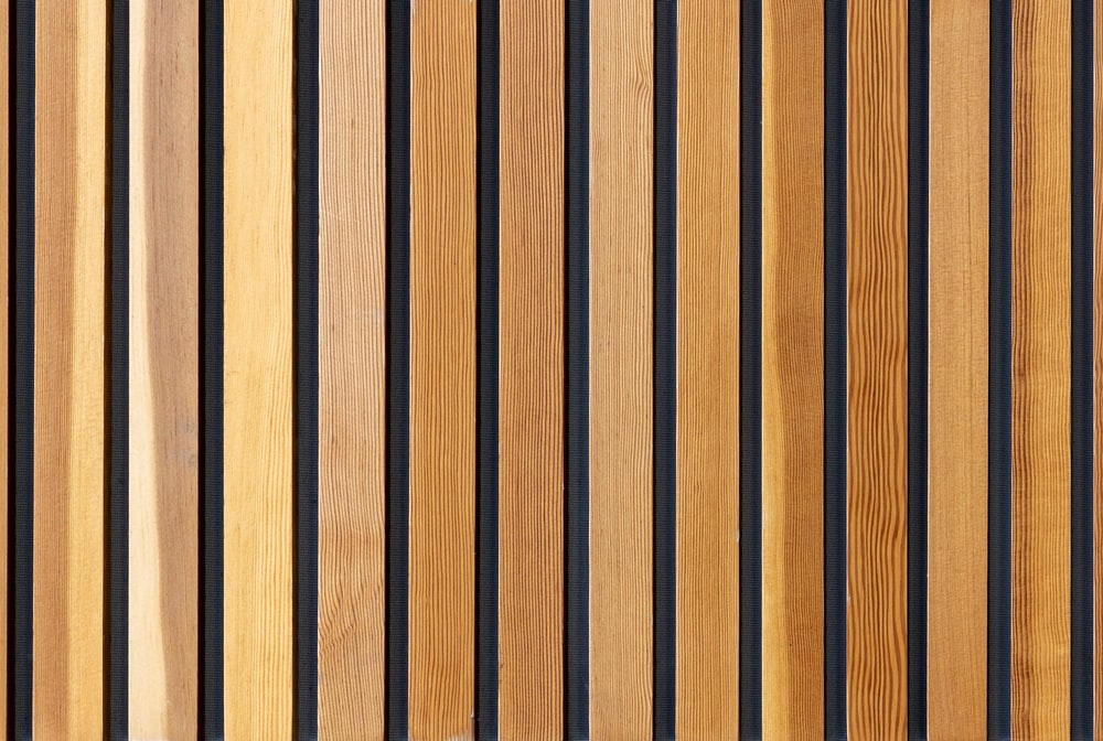 two brown wooden wall decors