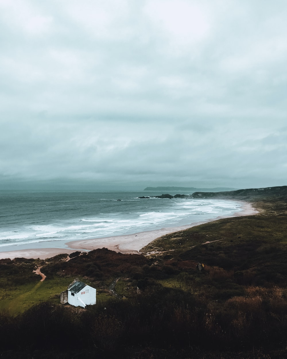 aerial view photography of house with ocean background