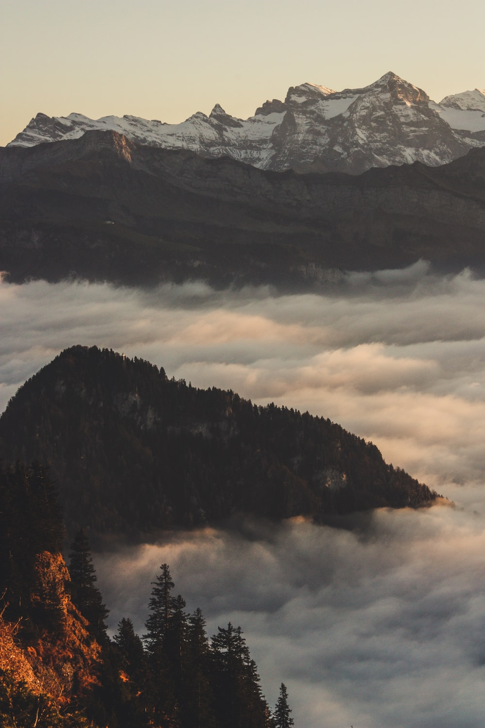 mountain covered with clouds during golden hour