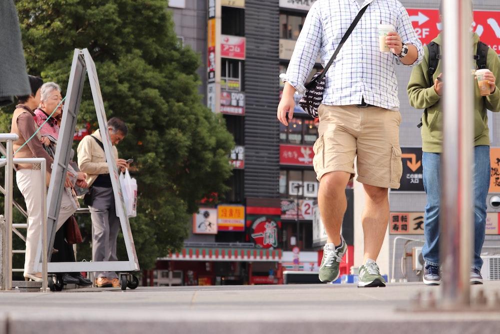 man walking near post