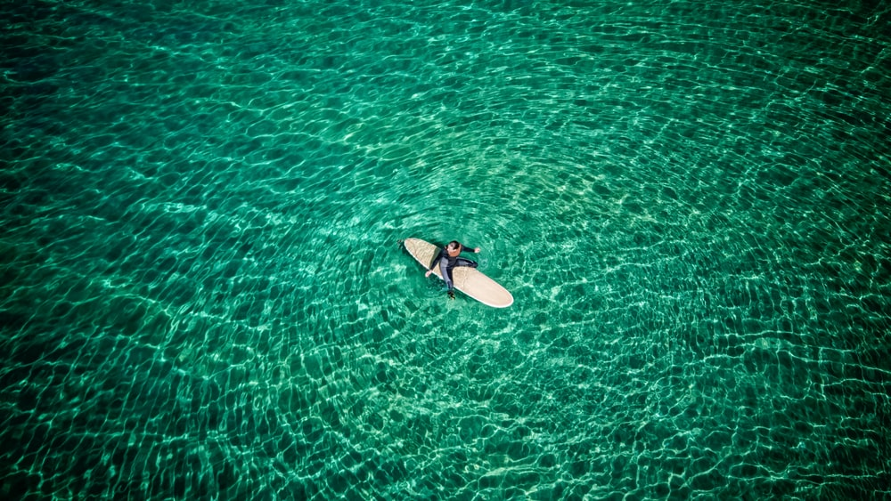 woman surfing on body of water