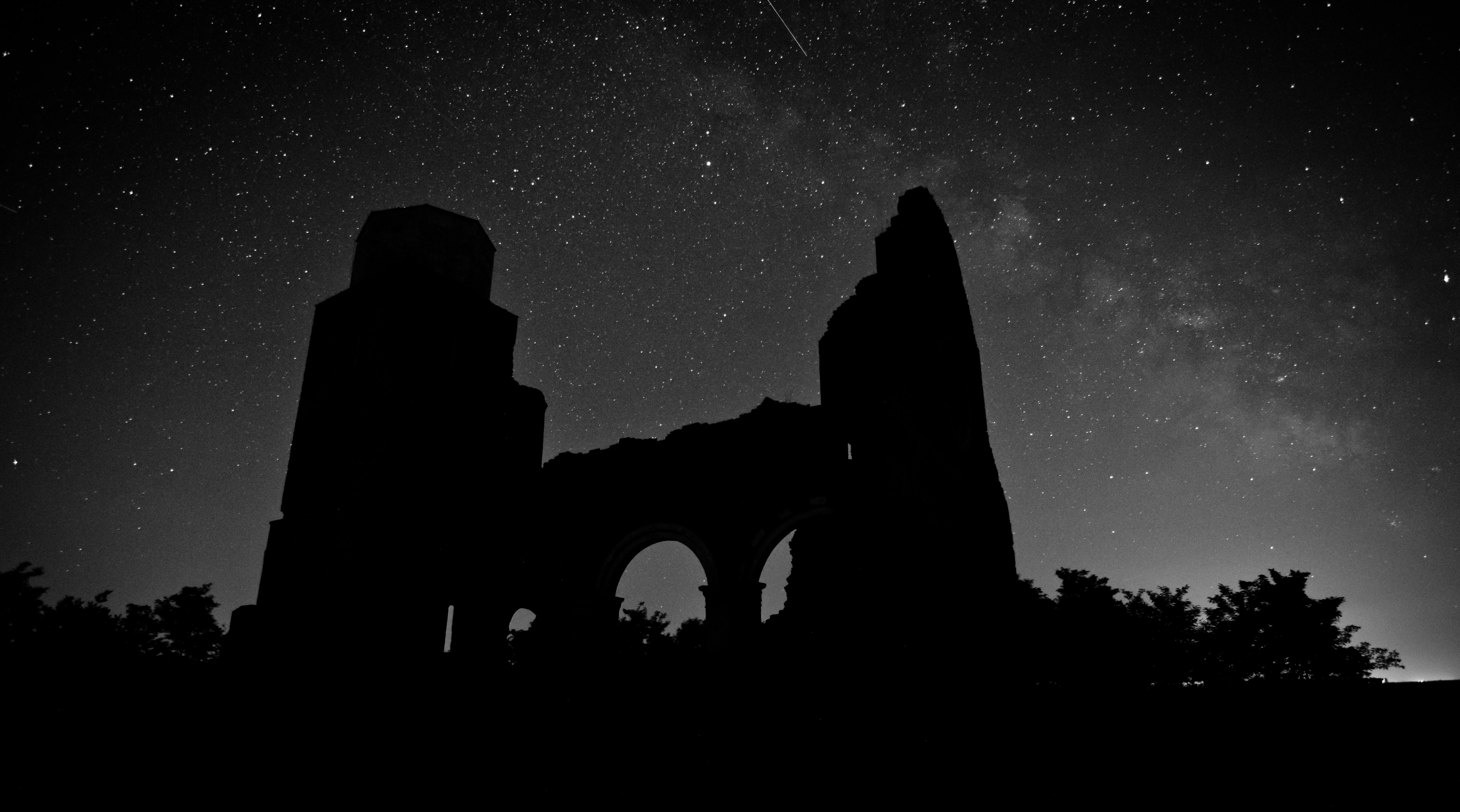 silhouette of ruins at nighttime